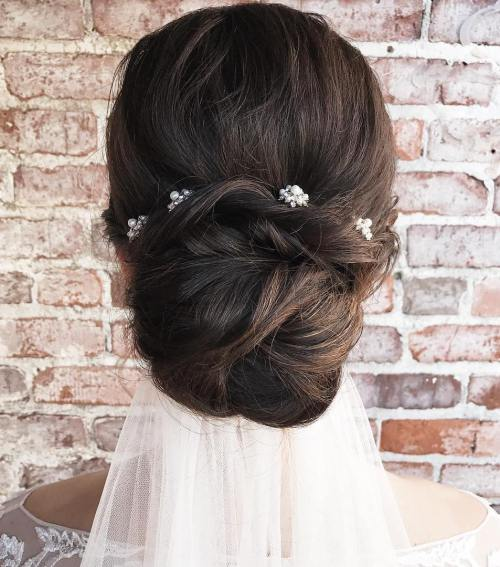 16 Low Wedding Bun With A Veil