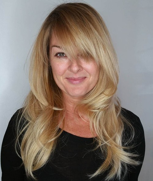 3 Layered Blonde Hairstyle With Bangs For Long Hair