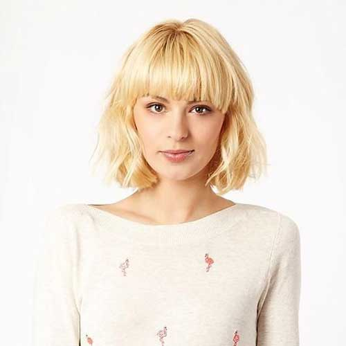 9.Short Haircut With Bangs